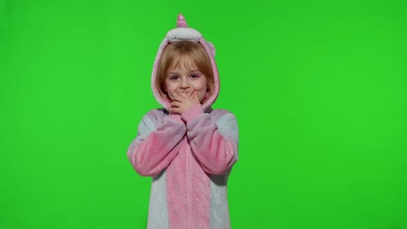 Amazed Astonished Young Kid Girl in Unicorn Costume Pajamas Showing Wow Reaction Perfect Surprise