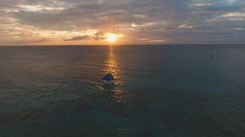 Sailing Yacht at Sunset