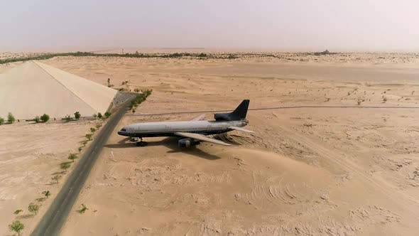 Aerial view of museum airplane on desert landscape, Abu Dhabi, U.A.E