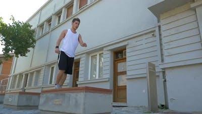 Young athlete performing parkour trick