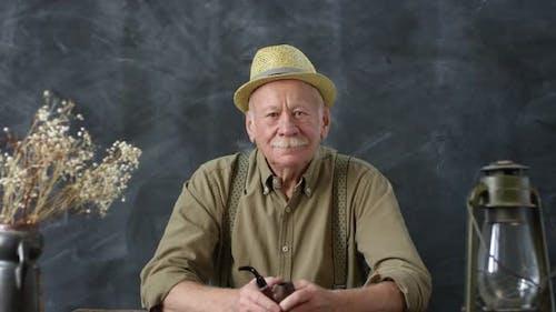 Portrait of Old-Fashioned Elderly Man