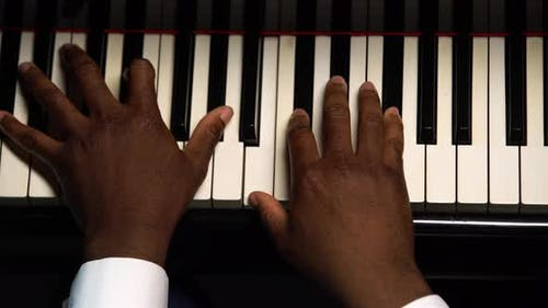 Top View of Male Hands Playing the Grand Piano