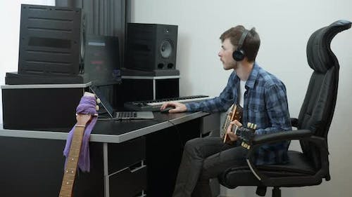 Sound engineer mixing and mastering pop rock song at home music recording studio