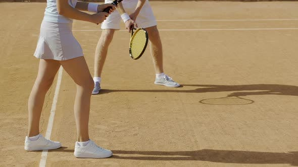 Thumbnail for Woman and man playing tennis at court, female hitting ball, active lifestyle