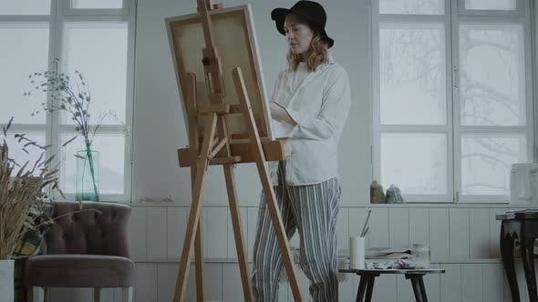 Thumbnail for Woman Artist Paints At An Easel