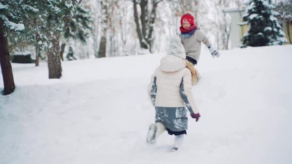 Thumbnail for Cheerful Children are Running Through the Snow and Playing Together in the Park in the Winter