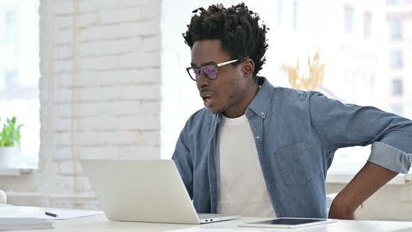 Thumbnail for Young African Man Having Back Pain in Office