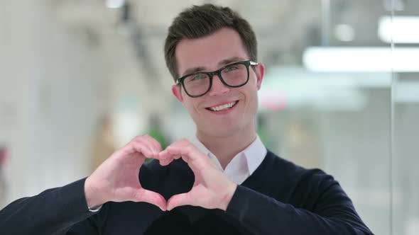 Young Businessman Showing Heart Sign with Hand