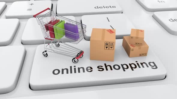 Shopping online via internet with shopping cart full with shopping bag and boxes