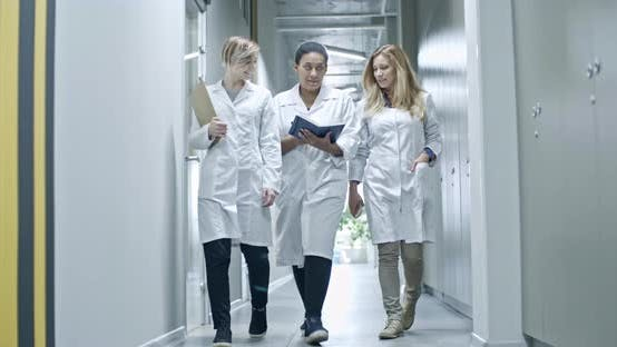Thumbnail for African Female Engineer Walking with Colleagues