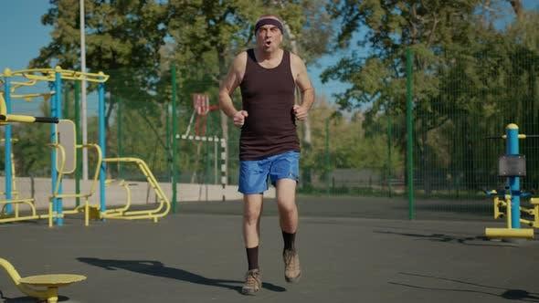 Thumbnail for Elderly Man Doing Exercise. Senior Man Running in Park. Health Lifestyle and Exercise Concept
