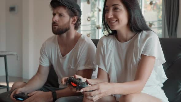 Thumbnail for Man and Woman Playing Video Games at Home