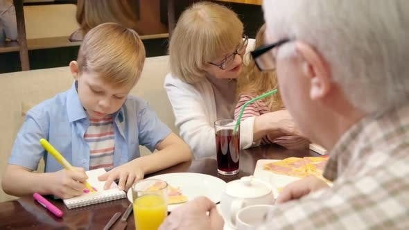 Thumbnail for Grandparents Having Leisure with Kids in Cafe