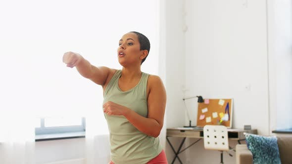 Thumbnail for African American Woman Exercising at Home