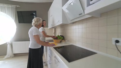 Granddaughter Cooking with Granny