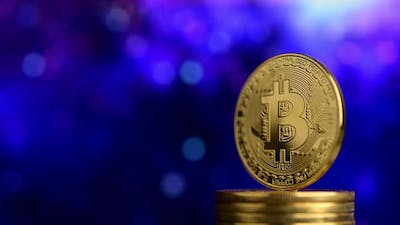 Bitcoin with blue bokeh background
