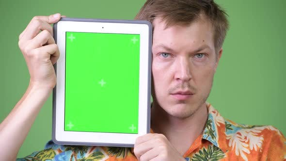 Thumbnail for Young Handsome Tourist Man Showing Digital Tablet