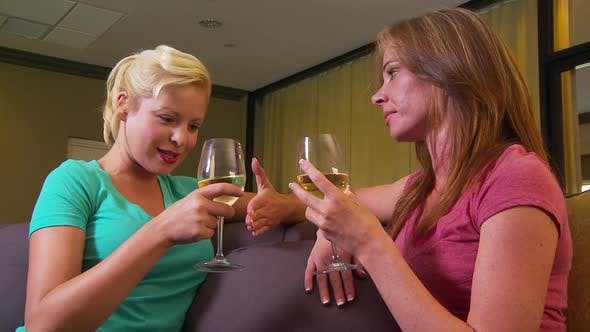 Thumbnail for Two women talking on couch drinking wine