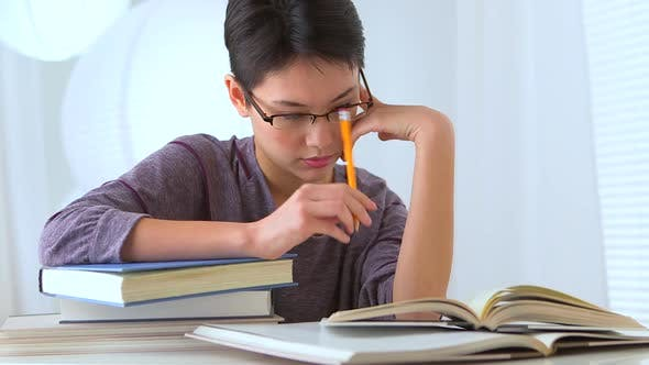 Thumbnail for Mixed race Asian woman studying