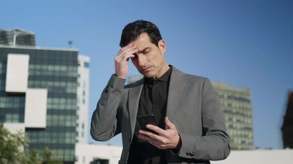 Thumbnail for Businessman Looking at Smartphone on Street. Entrepreneur Waiting for Partner