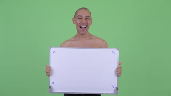 Thumbnail for Happy Bald Multi Ethnic Shirtless Man Holding White Board and Looking Surprised