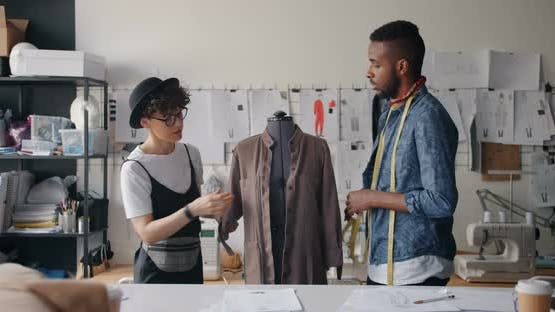 Dressmakers Measuring Garment on Mannequin with Measure-tape Talking