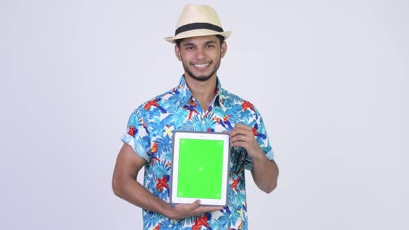 Thumbnail for Young Happy Bearded Indian Tourist Man Showing Digital Tablet
