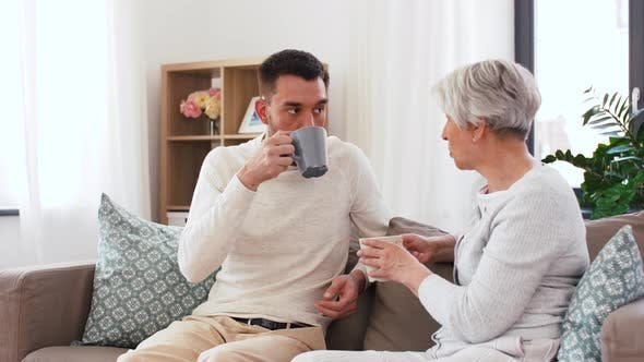 Cover Image for Adult Son and Senior Mother Drink Coffee at Home