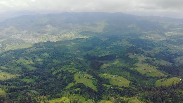 Aerial Drone View Mountains Covered with Green Grass and Green Trees. View of the Mountain Tops