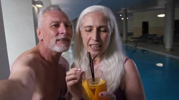 Thumbnail for Happy Aging Couple Taking Selfie By Hotel Pool