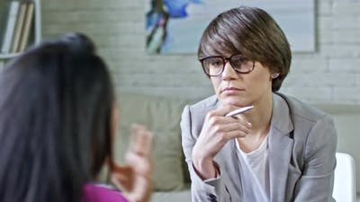Psychotherapist Listening to Patient