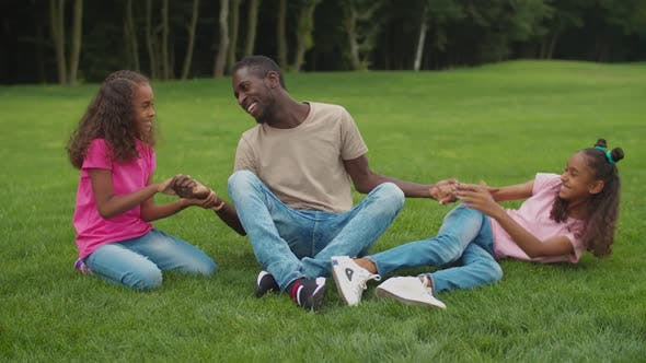 Thumbnail for African Dad with Girls Enjoying Leisure Outdoors