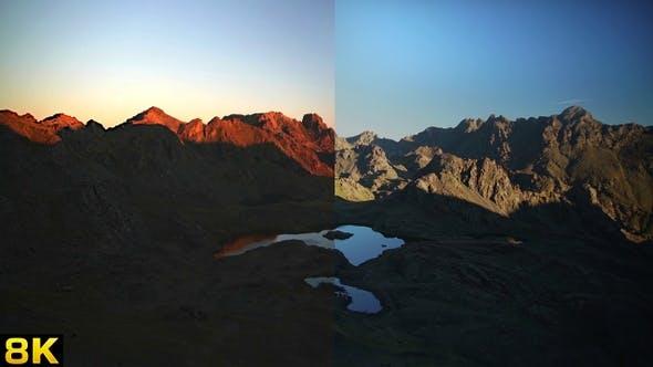 Thumbnail for Morning Sunrise Lights Reflected in Mountain Peaks