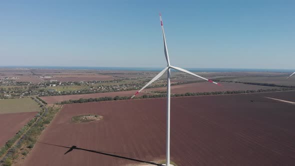 Thumbnail for Wind power turbines with big blades in fields against sea in Ukraine