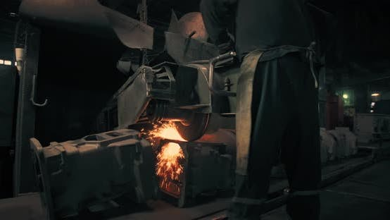 Thumbnail for Sparks that fly out when grinding metal of a large grinder. Diamond wheel. Metallurgical Plant