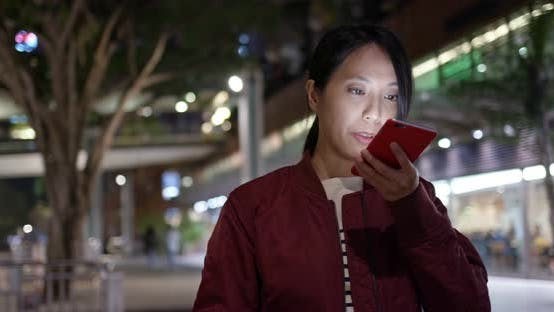 Thumbnail for Woman use of mobile phone in city at night