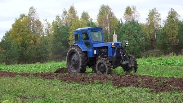 Old Soviet Tractor And Plowing 2
