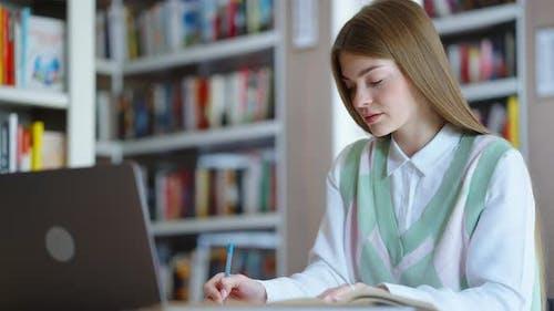 Student Doing Homework in Library