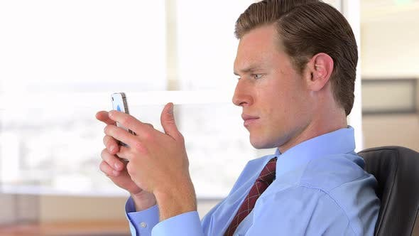 Thumbnail for businessman texting
