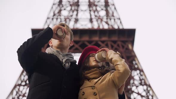 Thumbnail for Couple drinking hot beverage getting warm and enjoying beautiful view of sights