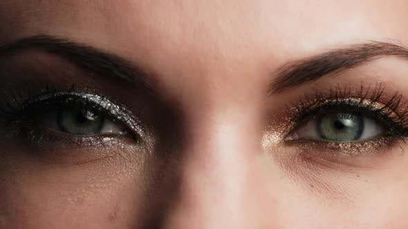 Thumbnail for Female with Beautiful Makeup, Glitter Shadows and False Lashes Opening Eyes. Womens Green Eye