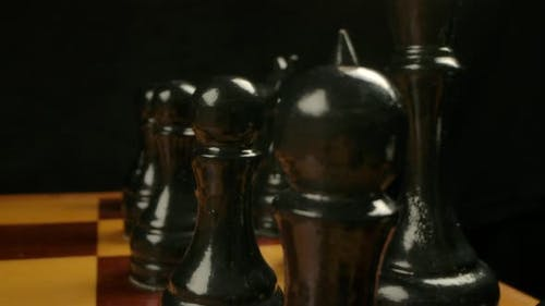 Dolly Camera Movement Behind Black Chess Pieces in Start Position