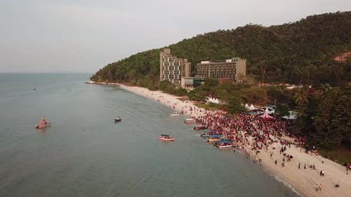 Aerial devotees gather at beach during sea floating chariot festival