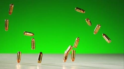 Bullets falling bouncing in ultra slow motion