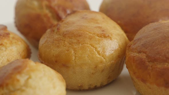 Thumbnail for Freshly baked cornmeal slow pan 4K 2160p 30fps UltraHD footage - Cornbread baked on plate close-up 3