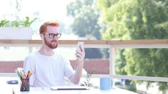 Thumbnail for Online Video Chat on Smartphone, Sitting in Balcony of Office Outdoor