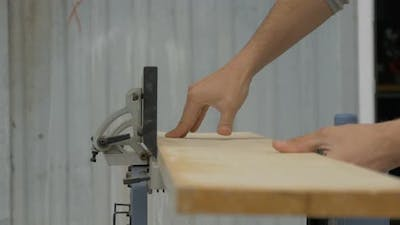 Carpenter using a joinery machine