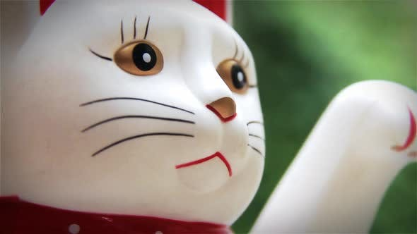 Lucky Cat, Fortune Cat or Welcoming Cat.