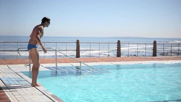 Thumbnail for Young man diving into swimming pool