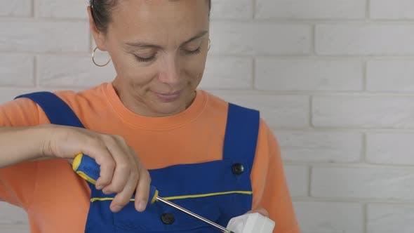 Woman Handyman with Screwdriver